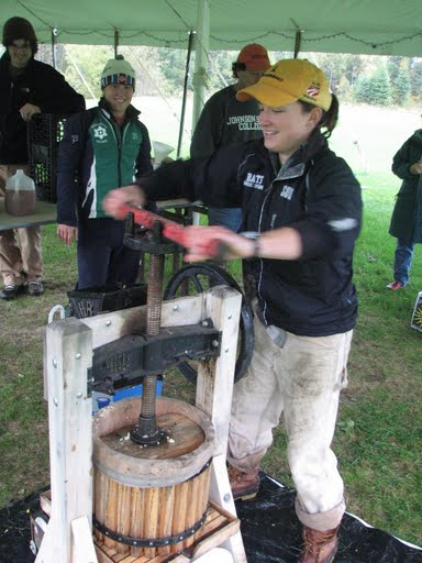 unrelated: Lauren presses cider as I watch at an event at the Outdoor Center. Photo: Judy Geer.